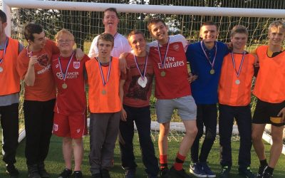 Youth Club presents medals to football league players